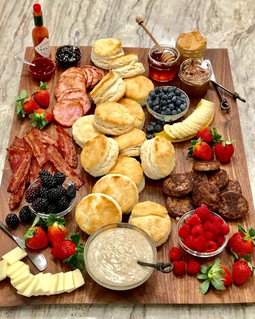 biscuit brunch board platter with bacon, sausage, and fruit