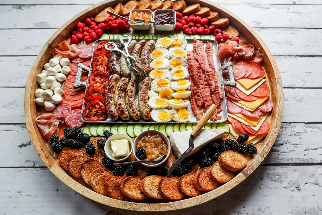 wood board filled with all the best breakfast foods