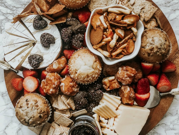 breakfast platter with muffins, strawberries, crackers and donut holes