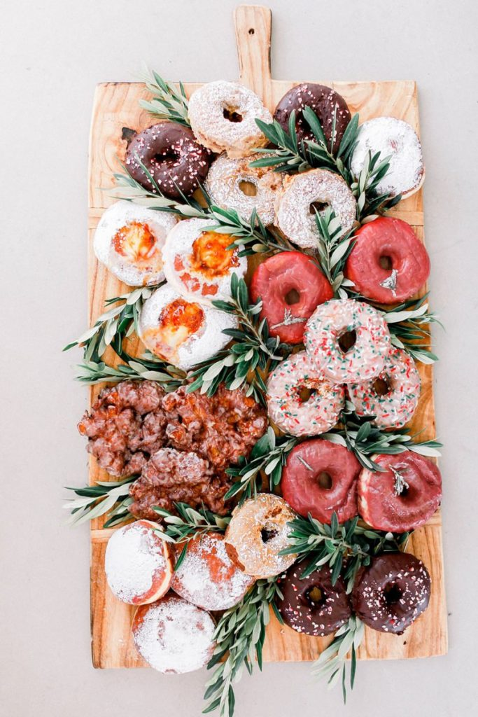 variety of donuts on a wood board
