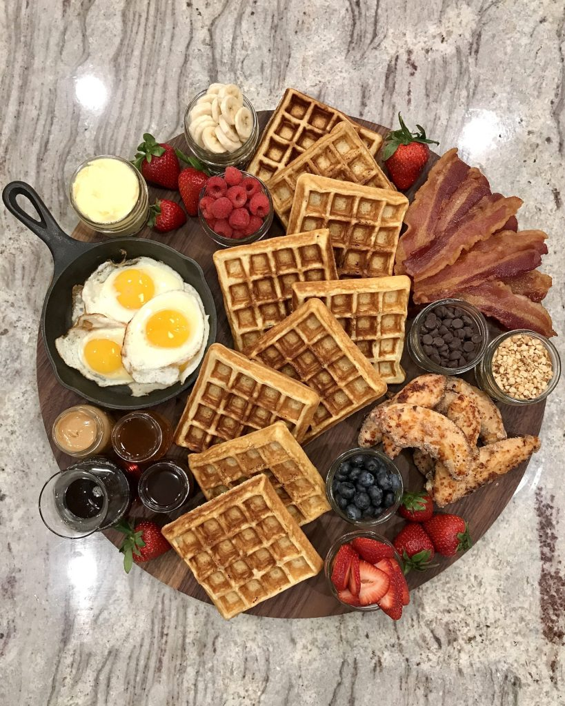 waffle breakfast platter with eggs and bacon